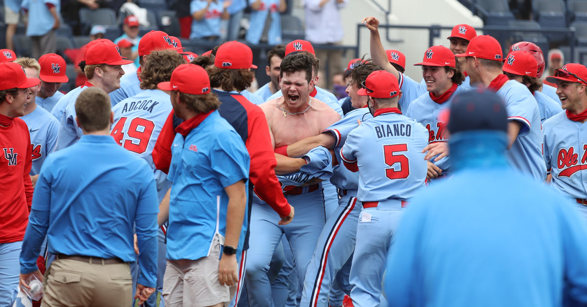 Ole Miss players rip the jersey off Kemp Alderman during the celebration of his game-winning walk-off home run Saturday afternoon. | Photo courtesy of Ole Miss Athletics
