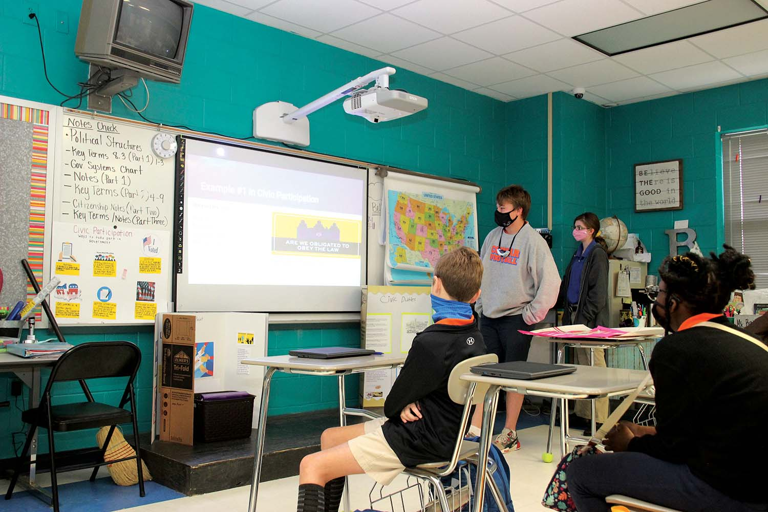 "Newton County Middle School sixth grader Zack Garvin presents his ""civic participation"" project in Jennifer Bailey's civics and the world social studies class this week. While students could research and present in a variety of ways, Garvin chose to create a Google slideshow for his visual support."