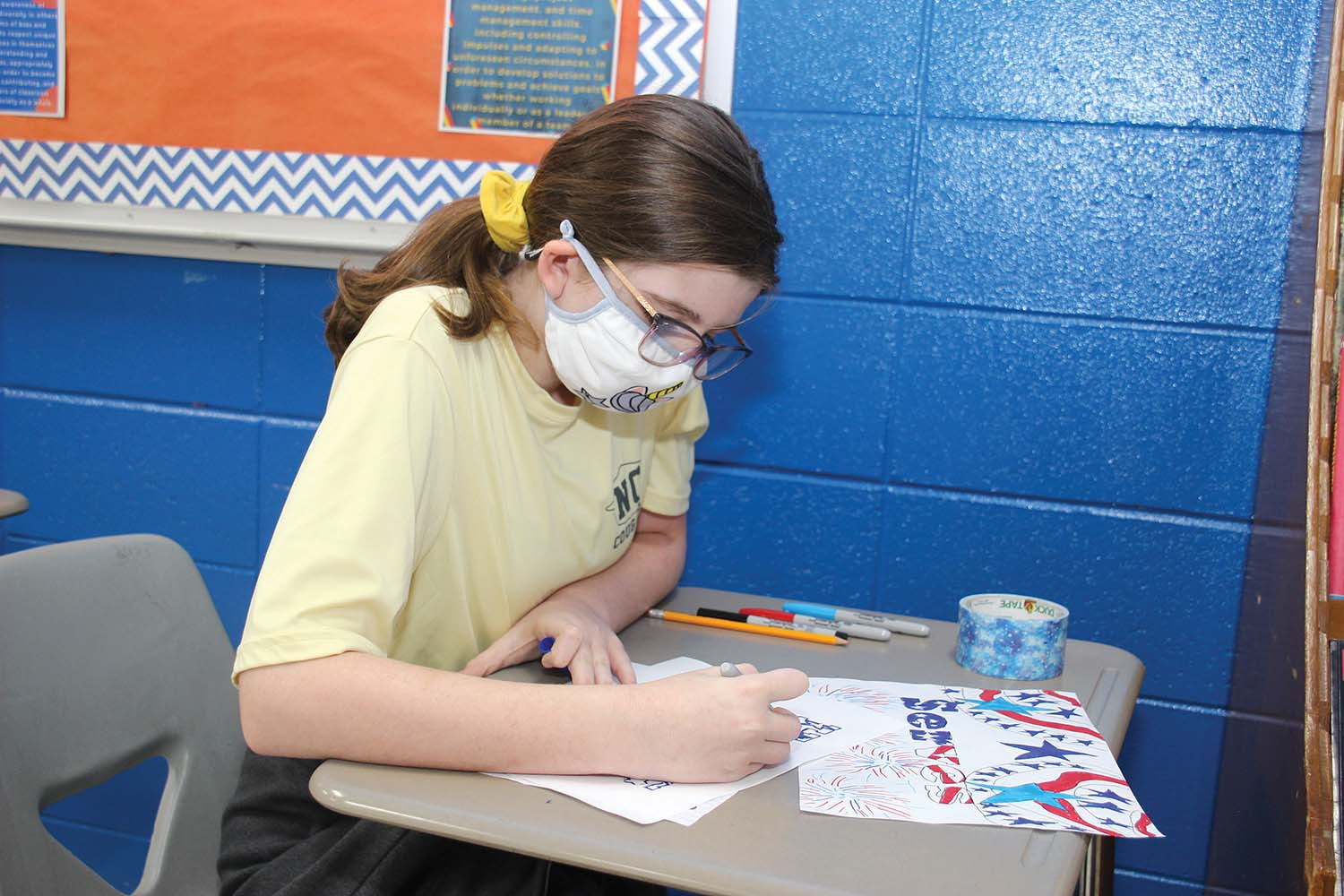 Chloe Cooper, a sixth grade student at Newton County Middle School, participates in the NCMS TAG Veterans Day initiative. Sixth grade TAG students developed resources and prepared a social media video and expressed appreciation to all veterans.